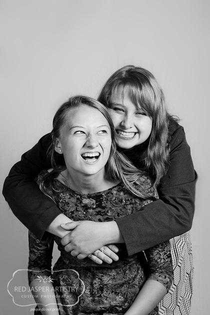 Capturing a moment between sisters is priceless.  A good laugh is something to treasure.